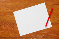 Red pencil and paper Stock Photography