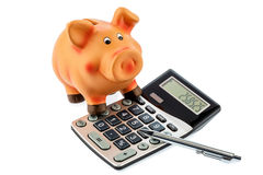 Red pencil, piggy bank and calculator Stock Photos