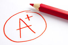 Red Pencil A Plus Grade Mark Success stock image