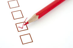 Red pencil and questionnaire on white paper. Stock Photos