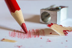 Red Pencil and Sharpener Stock Photos