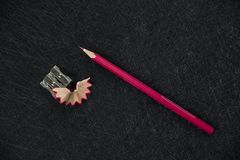 Red pencil sharpener and sharpened rubbish stock image