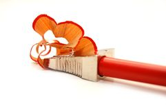 Red pencil and sharpener with a shaving Stock Images