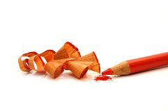 Red pencil and sharpener with a shaving Stock Image
