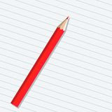 Red pencil on a sheet of paper Royalty Free Stock Image