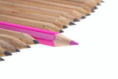 Red pencil among the simple. stock images