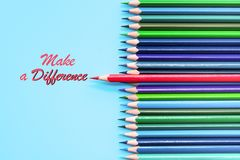 Red pencil standing out on blue background. Leadership, uniqueness, independence, initiative, strategy, dissent, think different,. Business concept stock image