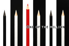 Red pencil standing out from crowd of black and white fellows on bw stripe background. business success concept of leadership uniq Royalty Free Stock Photos