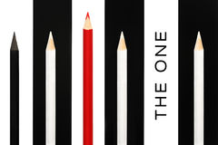 Red pencil standing out from crowd of black and white fellows on bw stripe background. business success concept of leadership uniq Stock Photos