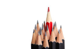 Red pencil standing out from crowd Royalty Free Stock Images