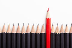 Red Pencil Standing Out From Crowd Royalty Free Stock Photos