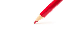 Red pencil on a white background Stock Photo