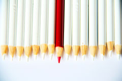 Red Pencil. A red pencil between white pencils Royalty Free Stock Images