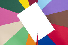 Red pencil and white sheet paper. Stock Photos