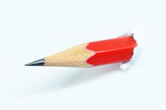 Red pencil and white torn paper Stock Images