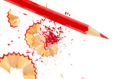 Red pencil and wood shavings Royalty Free Stock Photography