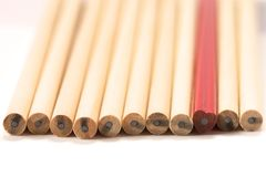 Red pencil among wooden Royalty Free Stock Photography