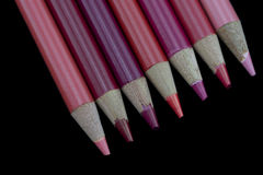 7 Red Pencils - Black Background Royalty Free Stock Photography