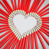 Red pencils heart shape. With shallow focus Royalty Free Stock Photo