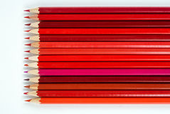 Red pencils. Several shades of red crayons Royalty Free Stock Photos