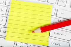 Red pensil and keyboard Royalty Free Stock Photos