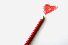 Red Pensil Red Heart Royalty Free Stock Photography