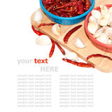 Red peppe and garlic on cutting board Royalty Free Stock Photos