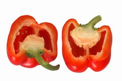 Red pepper. Sliced by halves, on a white background Royalty Free Stock Photography