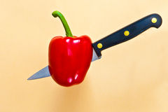 Red pepper. Being penetrated by a knife Stock Photo