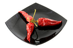 Red pepper. Pods of dried red pepper on a plate stock photo