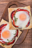Red pepper and baked egg galettes. Stock Photography