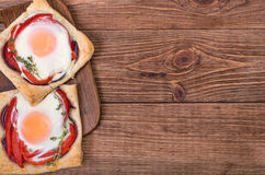 Red pepper and baked egg galettes. Stock Photo