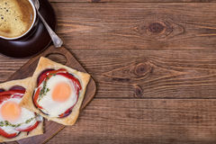 Red pepper and baked egg galettes and cup of coffee. Royalty Free Stock Photo