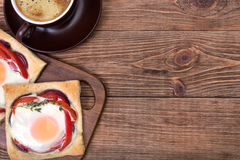 Red pepper and baked egg galettes and cup of coffee. Breakfast Stock Photography