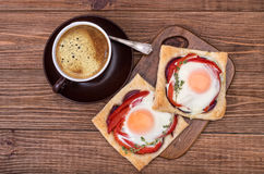 Red pepper and baked egg galettes and cup of coffee. Royalty Free Stock Photography