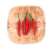 Red pepper on bamboo plate, on a white background Royalty Free Stock Photography