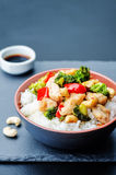 Red pepper broccoli cashew chicken stir fry with rice. Toning. selective Focus stock images