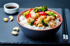 Red pepper broccoli cashew chicken stir fry with rice. Toning. selective Focus royalty free stock photo