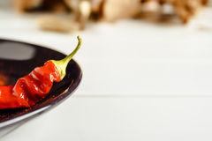 Red pepper on brown dish. Royalty Free Stock Photo