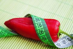 Red pepper with centimeter Royalty Free Stock Photography