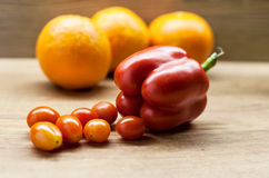 Red pepper cherry tomatoes and oranges. Stock Photo