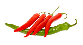 Red Pepper Chile On Green Pepper Stock Photos