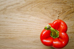 Red Pepper on Chopping Board. Flat lay shot of a red pepper Royalty Free Stock Photography
