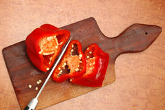 Red pepper cut on a board Royalty Free Stock Photo