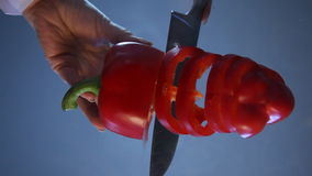 Red pepper cut on a glass table stock video