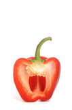 Red pepper cut in half. Photograph of a red sweet pepper cut in half  shot in studio against a white background Royalty Free Stock Image