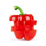 Red pepper cut in horizontal slices over white background.  Royalty Free Stock Images