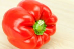 Red pepper on a cutting board isolated on white Stock Photo