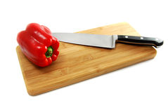 Red Pepper on Cutting Board Royalty Free Stock Images