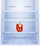 Red pepper in empty refrigerator. Stock Photo